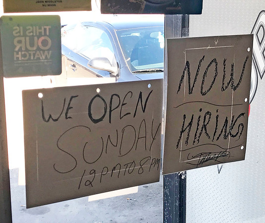 JOHN KLINE | THE GOSHEN NEWS<br /> A sign informing customers of the store's new Sunday hours can be seen taped to the door of the Mega Liquor & Smoke shop in Goshen Sunday afternoon.