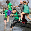 GEOFF LESAR | THE GOSHEN NEWS<br /> <br /> Participants in the 2018 Leprechaun Leap brace themselves before plunging into Simonton Lake Saturday afternoon. The annual event benefits United Cancer Services of Elkhart County, an organization offering emotional and financial support to cancer patients. Executive Director Pete Norton said he estimated 550 to 600 people gathered this year at Re-Pete's Simonton Lake Tavern, raising about $25,000.