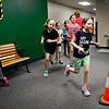 BEN MIKESELL | THE GOSHEN NEWS<br /> Second- and third-graders run through the hallways Thursday at Middlebury Elementary School, as part of the school's Run the Halls program. Students receive a popsicle stick after each completed lap, and every four sticks equals one mile. Physical Education teacher Angie Frey records the students performances throughout the six-week program to measure progress from beginning to end.