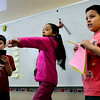 BEN MIKESELL | THE GOSHEN NEWS<br /> Third-grader Rebecca Acosta-Valdez winds up to throw a paper airplane, while her classmates Jacob Morningstar, left, and Lino Rodarte, right, prepare to record results Thursday in Nate Shenk's class at Chandler Elementary School. The students tested various paper airplanes, checking for distance and hang time as they took turns throwing them across the room, and recorded and stored the data using iPads.