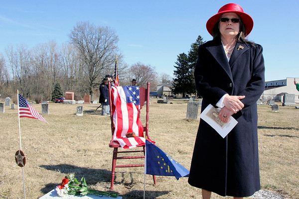 AIMEE AMBROSE | THE GOSHEN NEWS<br /> <br /> Elizabeth Thurston stands at the headstone of Arsinoe Martin, a Civil War nurse from Elkhart County. Martin is the namesake of a new heritage society that received a charter through the Ladies of the Grand Army of the Republic during a ceremony Sunday. The event included placing wreaths and flags at Martin's grave in the Pine Creek Cemetery on C.R. 23.