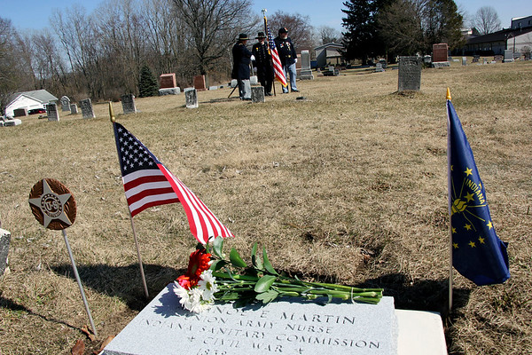 AIMEE AMBROSE | THE GOSHEN NEWS<br /> <br /> A new headstone marks the grave of Arsinoe Martin, a Civil War nurse from Elkhart County, at Pine Creek Cemetery on C.R. 23. Flags and wreaths were placed at the site Sunday during a ceremony to establish the new Arsinoe Martin Circle of the Ladies of the Grand Army of the Republic.