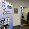 BEN MIKESELL | THE GOSHEN NEWS<br /> People enter the Elkhart County Health Department, where the Federal Emergency Management Agency (FEMA)  set up a disaster recovery center Friday in Elkhart.