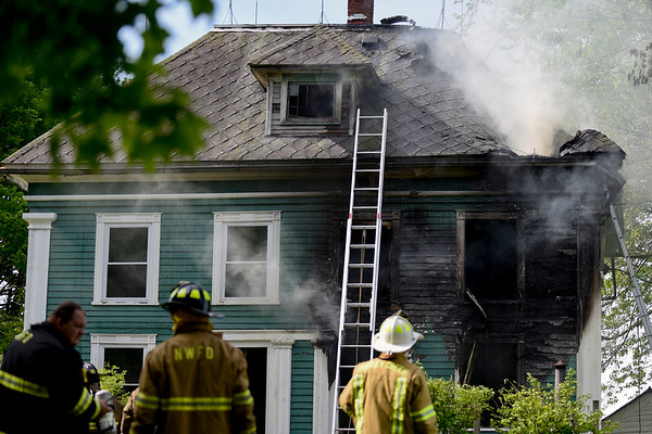 BEN MIKESELL | THE GOSHEN NEWS<br /> Firefighters from Syracuse, Milford and North Webster Fire Departments respond to a house fire Wednesday morning at 10469 N Syracuse Webster Road in Syracuse.