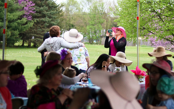 LEANDRA BEABOUT | THE GOSHEN NEWS<br /> Women gathered for photos, tea and snacks at the annual SPA Women's Ministry tea party.