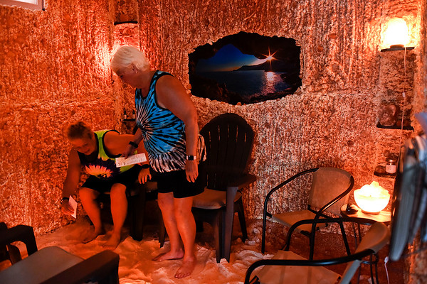 BEN MIKESELL | THE GOSHEN NEWS<br /> Ligonier residents Patty Schofe and Sandy Rakes try out the new salt cave Wednesday inside In-Style Salon in Goshen. Himalayan salt caves are beneficial in halotherapy, also known as salt therapy, and can improve respiratory and vascular health, owner Sabrina Klotz said.