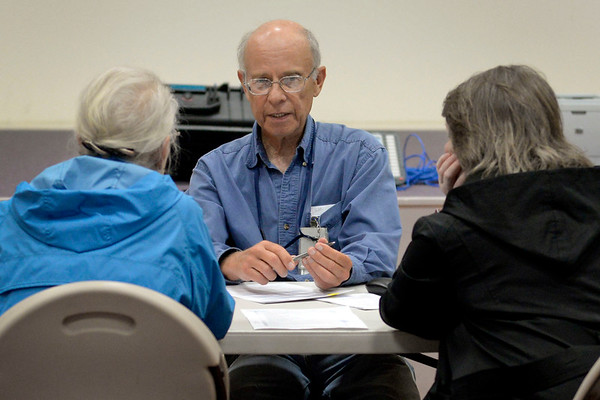 BEN MIKESELL   THE GOSHEN NEWS<br /> Richard McMahon, mitigation adviser with the Federal Emergency Management Agency, talks to a family from Elkhart Friday afternoon at the Disaster Recovery Center inside the Elkhart County Health Department.