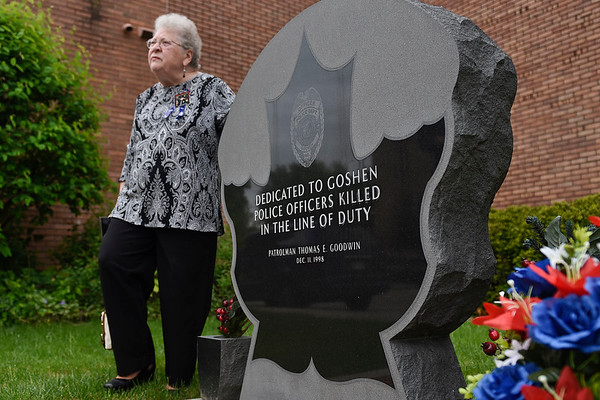 BEN MIKESELL   THE GOSHEN NEWS<br /> Sharon Johnson, aunt of former Goshen police officer Tom Goodwin, stands next to his memorial Friday afternoon outside the Goshen Police Department. This year marks the 20th anniversary since he was killed in the line of duty.