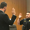 JOHN KLINE | THE GOSHEN NEWS<br /> Goshen Mayor Jeremy Stutsman, left, swears in Brian K. Abshire as a new probationary patrol officer with the Goshen Police Department during a meeting of the Goshen Board of Public Works and Safety Monday afternoon.
