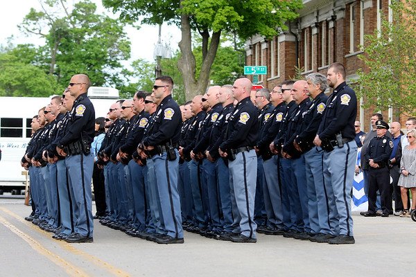 GEOFF LESAR | THE GOSHEN NEWS<br /> <br /> Members of Goshen Police Department gather outside the police station near the corner of Fifth and Jefferson streets Tuesday evening, part of National Peace Officers Memorial Day. The event recognized efforts of police officers, and honored those who have fallen in the line of duty, including Goshen Patrolman Thomas Goodwin, who was killed Dec. 11, 1998, while serving his community.