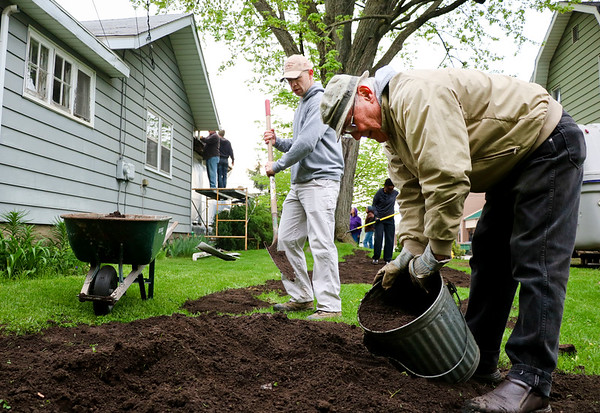 LEANDRA BEABOUT | THE GOSHEN NEWS<br /> Patrick Buller and Dick Yoder work on the yard of a house on Denver Ave. as part of LaCasa's annual Help a House day.