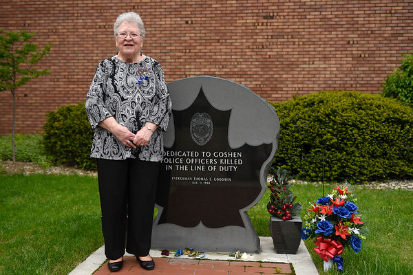 BEN MIKESELL | THE GOSHEN NEWS<br /> Sharon Johnson, aunt of former Goshen police officer Tom Goodwin, stands next to his memorial Friday afternoon outside the Goshen Police Department. This year marks the 20th anniversary since he was killed in the line of duty.