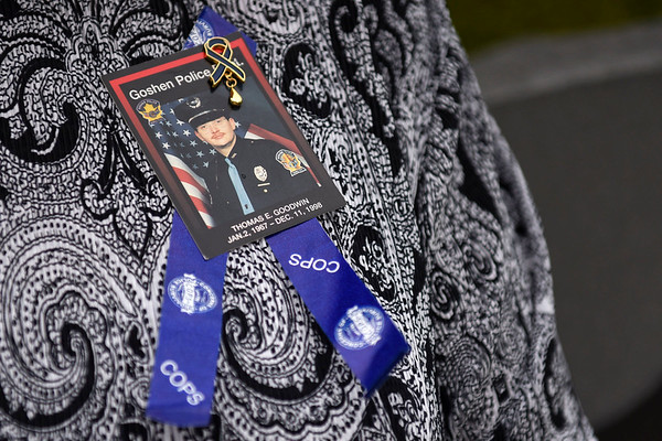 BEN MIKESELL | THE GOSHEN NEWS<br /> Sharon Johnson, aunt of former Goshen police officer Tom Goodwin, wears a pin honoring her late nephew Friday afternoon outside the Goshen Police Department. This year marks the 20th anniversary since he was killed in the line of duty.