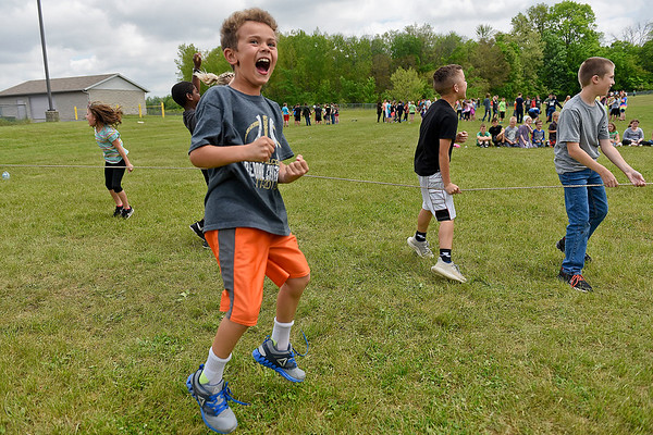 BEN MIKESELL | THE GOSHEN NEWS<br /> Second-grade student Austin Gall celebrates with classmates after winning in the tug-of-war event during Field Day Tuesday at Benton Elementary School.