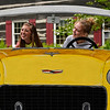 BEN MIKESELL | THE GOSHEN NEWS<br /> Sarah Romero, left, and Hannah Longacre, both sophomores at Northridge High School, pose for a photo behind a car cutout while attending the Lemonpalooza event for Lemonade Day Saturday at Das Dutchman Essenhaus in Middlebury.