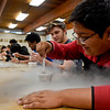 BEN MIKESELL | THE GOSHEN NEWS<br /> Bethany Christian junior Carlos Orellana stirs his cup of liquid nitrogen ice cream during ninth-period chemistry class Wednesday at Bethany Christian Schools. Because the liquid nitrogen froze the mixture instantly, the ice cream was smoother than traditionally made ice cream.