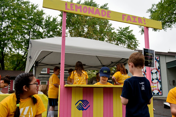 BEN MIKESELL   THE GOSHEN NEWS<br /> The lemonade stand organized by the Boys and Girls Club sells strawberry lemonade and lemon shakeups during the Lemonpalooza event for Lemonade Day Saturday at Das Dutchman Essenhaus in Middlebury.