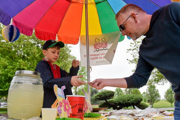 BEN MIKESELL | THE GOSHEN NEWS<br /> Jack Gorski, 10, Middlebury, makes a sale with Chris Longacre, Middlebury, during Junior Achievement's Lemonpalooza event Saturday at Das Dutchman Essenhaus in Middlebury.