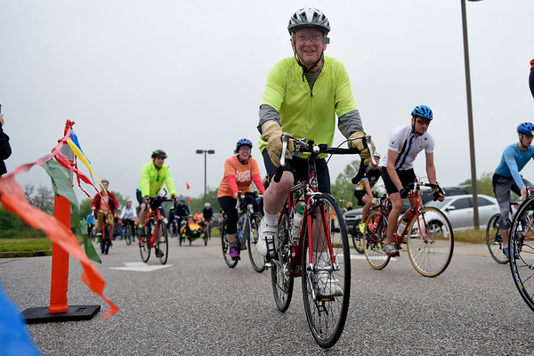 BEN MIKESELL | THE GOSHEN NEWS<br /> Bill Cavanaugh, Bristol, rides past the start line during ADEC's Ride-A-Bike fundraiser Saturday in Middlebury. Cavanaugh has been participating in the bike race since its inception.