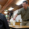 BEN MIKESELL | THE GOSHEN NEWS<br /> Bethany Christian Schools chemistry teacher Calvin Swartzendruber pours an ice cream mix into a student's cup during ninth-period Wednesday at Bethany Christian. Swartzendruber later poured in liquid nitrogen to create ice cream.