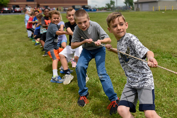 BEN MIKESELL | THE GOSHEN NEWS<br /> Second-grade students in Charlotte Oswald's class particpate in the tug-of-war during Field Day Tuesday at Benton Elementary School.