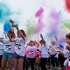 BEN MIKESELL | THE GOSHEN NEWS<br /> The front line of the Color Our World 5K tosses paint powder into the air Saturday before the start of the walk, a new addition to ADEC's Ride-A-Bike fundraiser at Northridge High School in Middlebury.