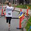 BEN MIKESELL | THE GOSHEN NEWS<br /> Liz Martin, Goshen, is the first to cross the finish line during Saturday's Color Our World 5K, a new addition to ADEC's Ride-A-Bike fundraiser at Northridge High School in Middlebury.