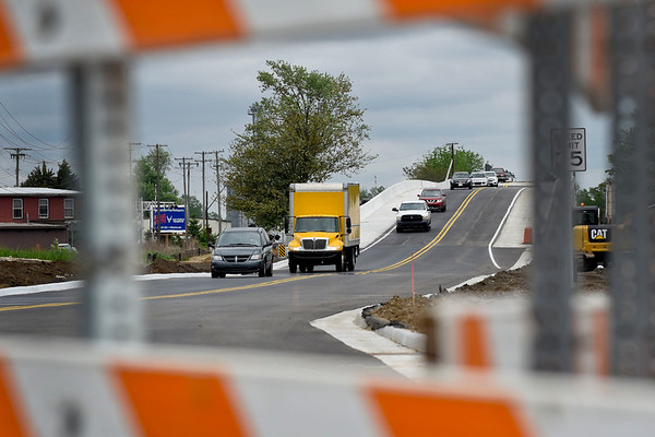 BEN MIKESELL | THE GOSHEN NEWS<br /> Drivers make their way across the US 33 connector route Tuesday in Goshen. Only the north-bound lane is open currently, and the south-bound lane will open in the coming weeks.