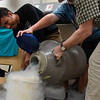 BEN MIKESELL | THE GOSHEN NEWS<br /> KeShawn Smith, junior at Bethany Christian Schools, helps his teacher Calvin Swartzendruber pour liquid nitrogen during ninth-period Wednesday in Bethany Christian's chemistry class.