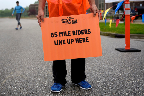 BEN MIKESELL | THE GOSHEN NEWS<br /> A sign at the front of the pack signals for those wanting to ride for 65 miles for ADEC's Ride-A-Bike event at Northridge High School Saturday in Middlebury.