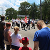 JULIE CROTHERS BEER | THE GOSHEN NEWS<br /> Military veterans march along Main Street in Syracuse Monday during the Memorial Day parade after stopping at the bridge to honor U.S. Navy personnel lost at sea.