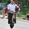 JULIE CROTHERS BEER | THE GOSHEN NEWS<br /> Scott Abbs of Syracuse plays the bagpipe while marching in the Memorial Day parade Monday in Syracuse.