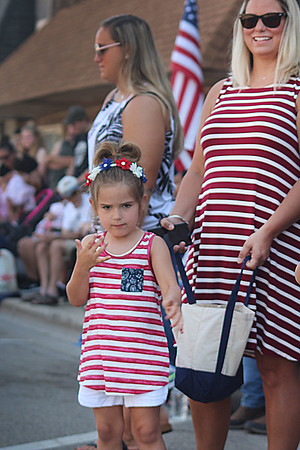 JULIE CROTHERS BEER | THE GOSHEN NEWS<br /> Londyn Peterson, 3, and her mom Shalesta Peterson, both of Fort Wayne, watch as the Milford Memorial Day parade passes on Main Street.