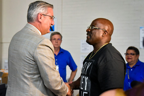 "BEN MIKESELL | THE GOSHEN NEWS<br /> Governor Eric Holcomb greets Mark Walker, Elkhart, during a visit to the Disaster Recovery Center Wednesday in Elkhart. Mark and Rose Walker were at the center to close on a loan with the U.S. Small Business Administration (SBA). ""We were told they wouldn't be able to help,"" Mark said. ""but the loans are not only for businesses. They're for renters, too."" The Walker's basement in Elkhart was flooded and was not covered by the Federal Emergency Management Agency's (FEMA) flood assistance program, so they applied for a loan with the SBA."