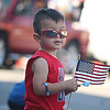 JULIE CROTHERS BEER | THE GOSHEN NEWS<br /> Aiden Argumedo-Antu, 2, of Milford holds a flag as he watches the Memorial Day parade Monday in Milford.