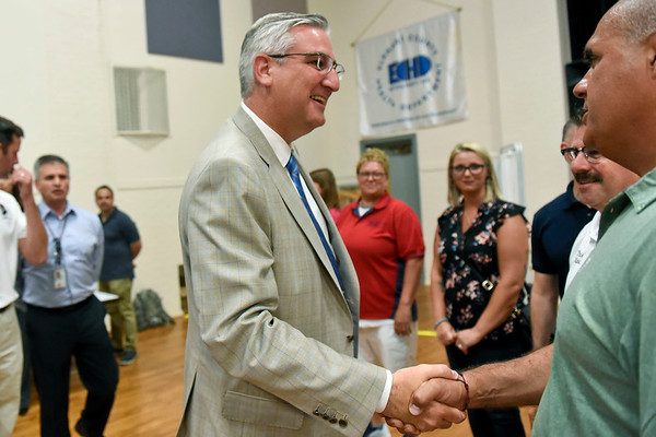 BEN MIKESELL | THE GOSHEN NEWS<br /> Governor Eric Holcomb greets Frank Lucchese during a visit to the Disaster Recovery Center Wednesday in Elkhart.