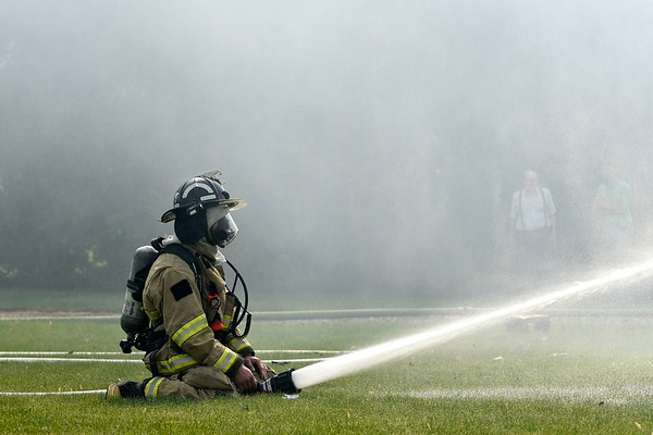 BEN MIKESELL | THE GOSHEN NEWS<br /> Clinton Township Fire Fighter Brian Borkholder sprays water on a house fire Tuesday morning at 11230 C.R. 34 east of Goshen.