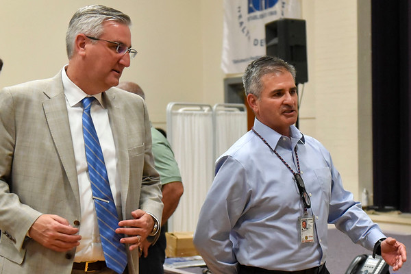 BEN MIKESELL | THE GOSHEN NEWS<br /> Governor Eric Holcomb, left, is escorted by Federal Emergency Management Agency (FEMA) Federal Coordinating Officer David Samaniego during a visit to the Disaster Recovery Center Wednesday in Elkhart.