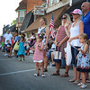 JULIE CROTHERS BEER | THE GOSHEN NEWS From left, Chassy Gallmeier of Churubusco, Londyn Peterson, 3, and Shalesta Peterson, of Fort Wayne, and Kellie, Kyle and Everlie Newcomer, 3, all of Syracuse, watch as the Milford Memorial Day parade passes along Main Street.