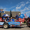 JULIE CROTHERS BEER | THE GOSHEN NEWS<br /> Chidlren on the Blue Barn Berry Farm's float wave to parade attendees during Monday's Memorial Day parade in Milford.