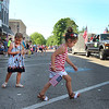 JULIE CROTHERS BEER | THE GOSHEN NEWS<br /> Everlie Newcomer, 4, of Syracuse and Londyn Peterson, 3, of Fort Wayne pick up candy during the Memorial Day parade Monday in Milford.
