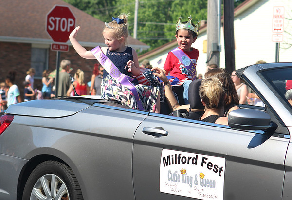 JULIE CROTHERS BEER | THE GOSHEN NEWS<br /> Cutie Queen Quinn Risedorph and King Isaias DeCuir wave to parade attendees Monday during the Memorial Day parade in Milford.