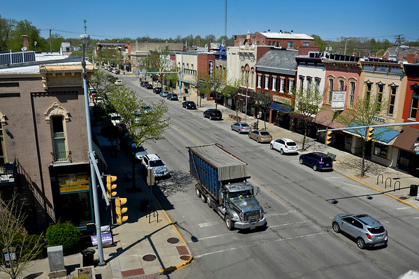 BEN MIKESELL | THE GOSHEN NEWS<br /> Cars drive down Main Street Monday afternoon in downtown Goshen. The city is considering making changes to Main Street, which include plans to change the road to two lanes and add diagonal parking.
