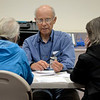 BEN MIKESELL | THE GOSHEN NEWS<br /> Richard McMahon, mitigation adviser with the Federal Emergency Management Agency, talks to a family from Elkhart Friday afternoon at the Disaster Recovery Center inside the Elkhart County Health Department.