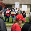 BEN MIKESELL | THE GOSHEN NEWS<br /> Protesters stand across Cassopolis Street, holding signs facing those in line for President Donald Trump's rally at North Side Gym in Elkhart.