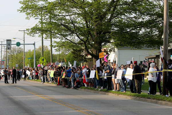 GEOFF LESAR | THE GOSHEN NEWS<br /> <br /> Protesters line Cassopolis Street prior to President Donald Trump's rally Thursday evening at North Side Middle School in Elkhart.