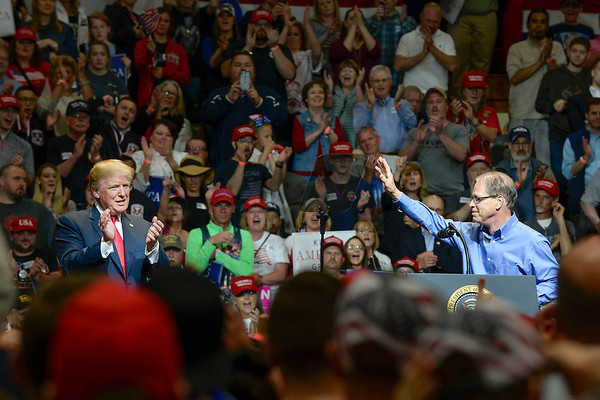 BEN MIKESELL | THE GOSHEN NEWS<br /> Republican senate candidate Mike Braun, right, is introduced by President Donald Trump during Thursday night's rally at North Side Gym in Elkhart, Indiana.