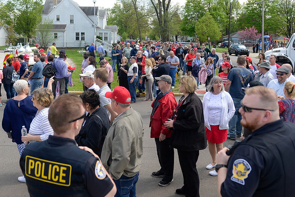BEN MIKESELL | THE GOSHEN NEWS<br /> People wait in line to get into North Side Gym for President Donald Trump's rally Thursday at North Side Gym in Elkhart.