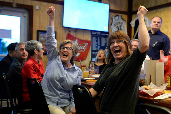 BEN MIKESELL | THE GOSHEN NEWS<br /> Val Collins, right, and Marilyn Graber, left, celebrate the passing of the Goshen Community School referendum in the primary election Tuesday evening at Wings Etc. in Goshen. The Goshen Schools Operating Referendum passed at 53.93 percent, and the Construction Referendum passed at 51.72 percent.