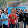 GEOFF LESAR | THE GOSHEN NEWS<br /> <br /> A crowd gathers across the street from protesters Thursday evening following President Donald Trump's arrival in Elkhart.